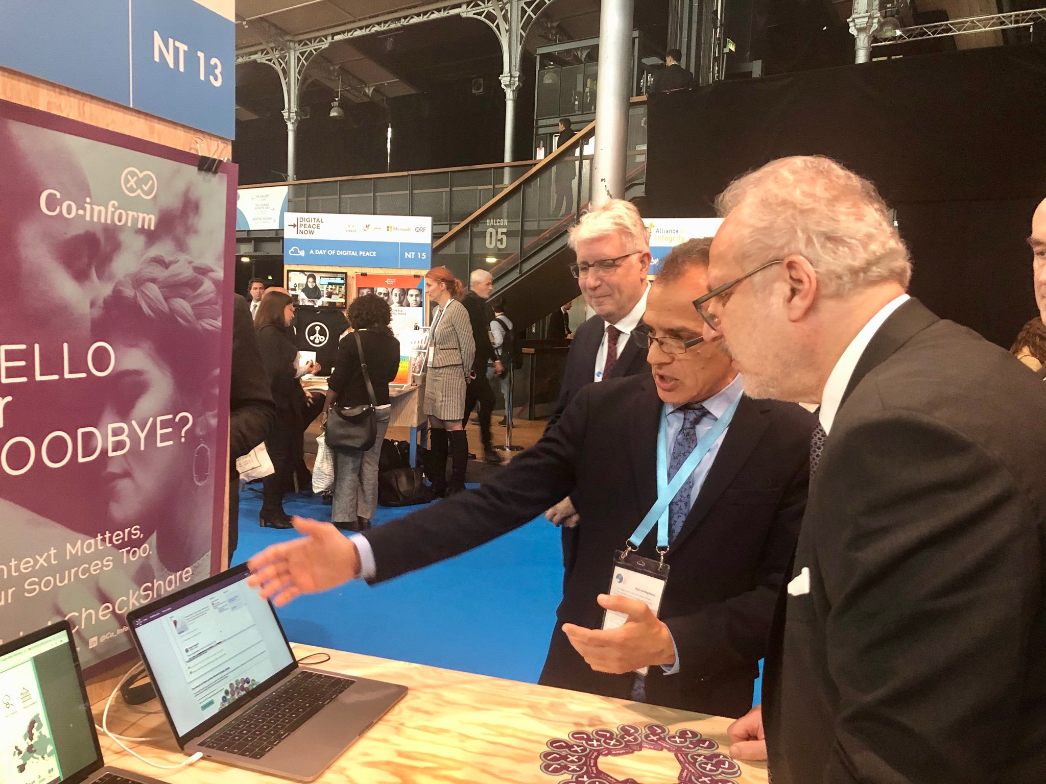 The President of Latvia, Mr. Egils Levits, visiting Co-Inform stand at the Paris Peace Forum